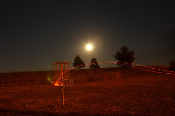Autumn rounds often extend into the night, meaning it's time to tape lights to the discs. (photo courtesy Flying Lea Disc Golf Club)